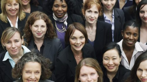 Group of business women looking up, portrait, elevated view, close up